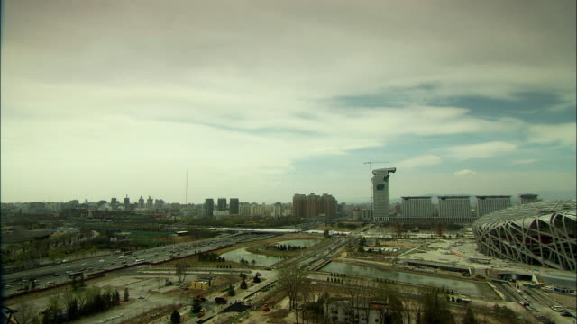 ws pan skyline with beijing national stadium, beijing, china - 2008 stock videos and b-roll footage