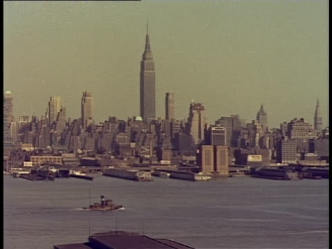 1940 WS HA Skyline with Empire State Building and ships on river / New York City, New York, USA