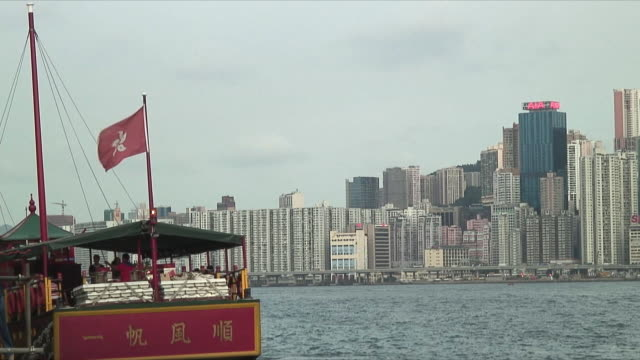 ms skyline with ferry in foreground, hong kong, china - hong kong flag stock videos & royalty-free footage