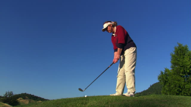 skylined woman golfer - see other clips from this shoot 1271 stock videos & royalty-free footage