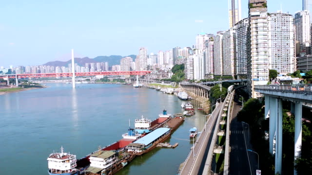 skyline,transportation and modern buildings of chongqing at riverbank,real time. - monorail stock videos and b-roll footage