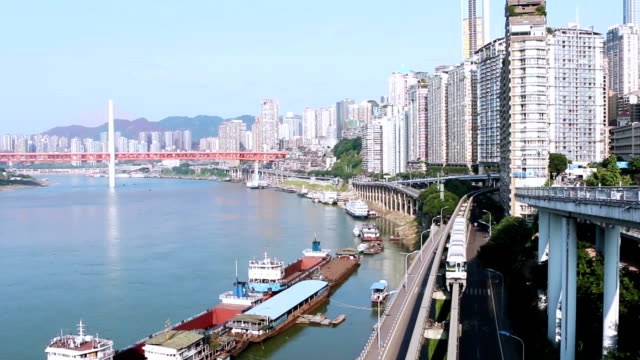 skyline,transportation and modern buildings of chongqing at riverbank,real time. - monorail stock videos & royalty-free footage