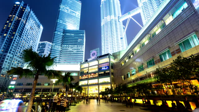 skyline,walking crowds and skyscrapers exterior in kuala lumpur,hyperlapse.