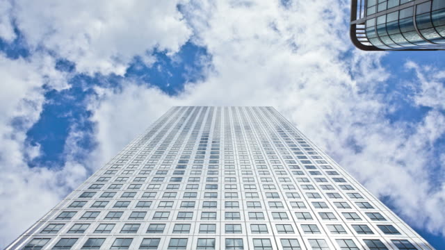 skyscraper and clouds timelapse, hd video - low angle view stock videos & royalty-free footage