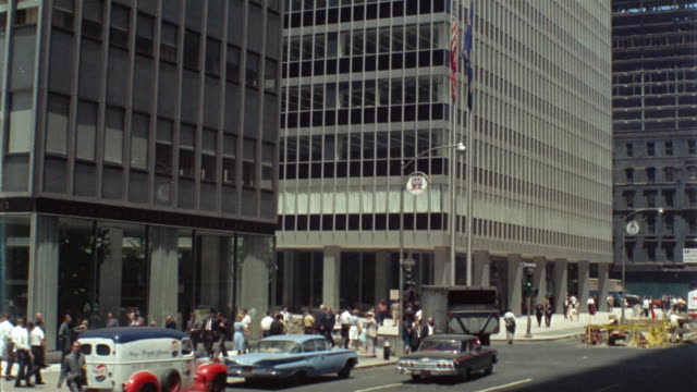 1960 ws tu zi skyscraper and pedestrians, w. 51st street and  6th ave,, new york city, new york, usa - 1960 stock videos & royalty-free footage