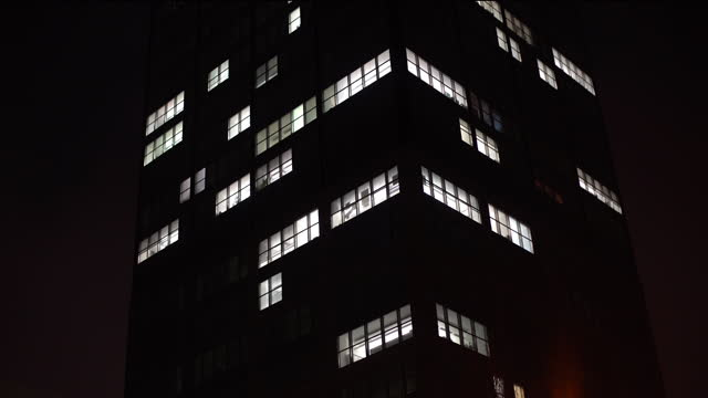 skyscraper at night. all the lights go out, time lapse - the end stock videos & royalty-free footage