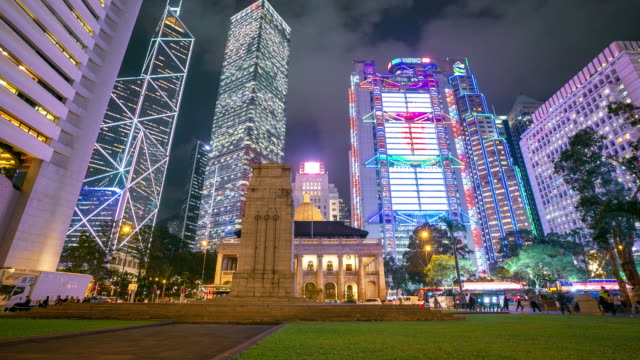 skyscraper crowded buildings at night, hong kong time lapse - martial arts stock videos & royalty-free footage