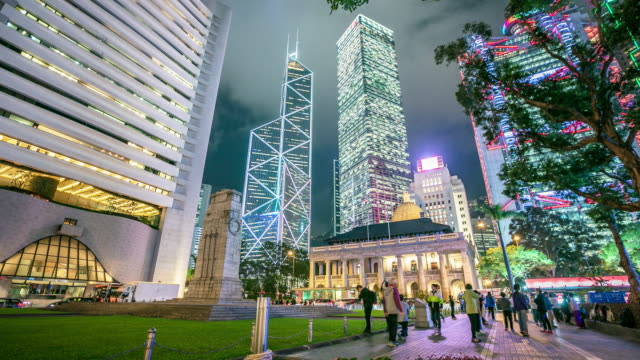 skyscraper crowded buildings at night, hong kong time lapse - composite image stock videos & royalty-free footage
