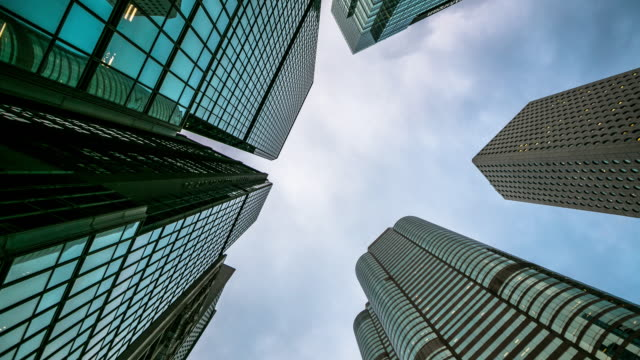 skyscraper crowded tall buildings with sky and cloud above the tower, time lapse - low angle view stock videos & royalty-free footage