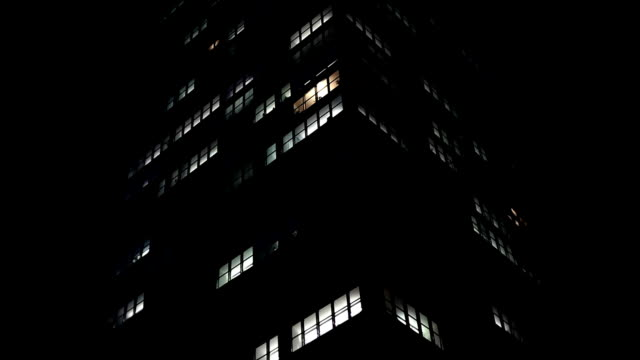 skyscraper in the night - office block exterior stock videos & royalty-free footage