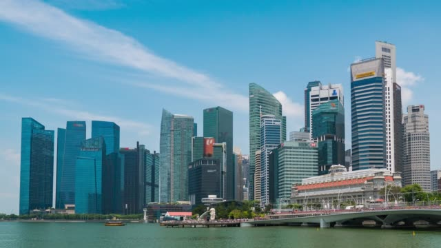 skyscraper on marina bay with blue sky, singapore, time lapse video - marina bay singapore stock videos and b-roll footage