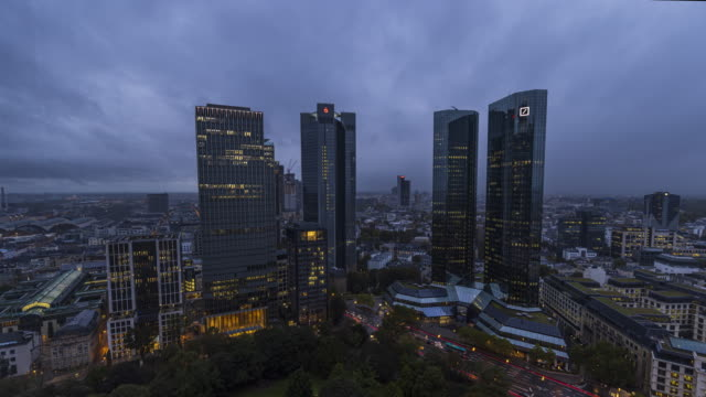 skyscraper panorama of frankfurt in a day to night transition - wop productions stock-videos und b-roll-filmmaterial