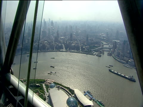 skyscrapers and huangpu river seen from pearl orient tower shanghai - river huangpu stock videos & royalty-free footage