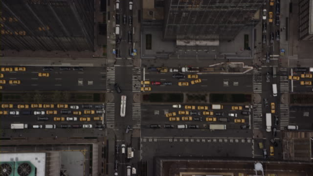aerial skyscrapers and streets, new york city, new york, usa - yellow taxi video stock e b–roll
