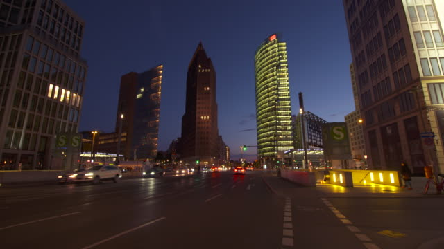 Skyscrapers and traffic at Potsdamer Platz at dusk twilight. Potsdamer Platz, Berlin, Germany.
