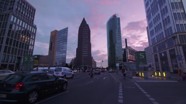 Skyscrapers and traffic at Potsdamer Platz with beautiful sunset. Potsdamer Platz, Berlin, Germany.
