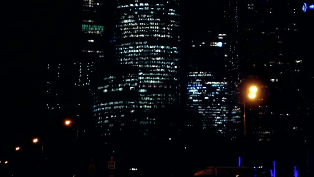 skyscrapers at night with road traffic - saturated colour stock videos & royalty-free footage