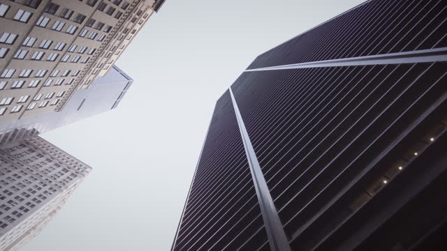 skyscrapers - classic low angle view. daytime. with sky and subtle camera rotation and movement. video: thompics - sk / getty images - black colour stock videos & royalty-free footage
