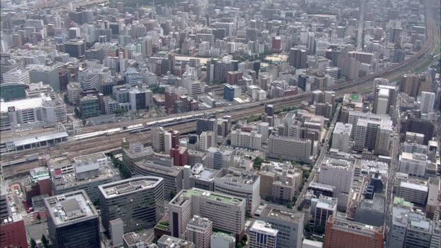 vídeos de stock, filmes e b-roll de skyscrapers crowd fukuoka city, japan. - prefeitura de fukuoka