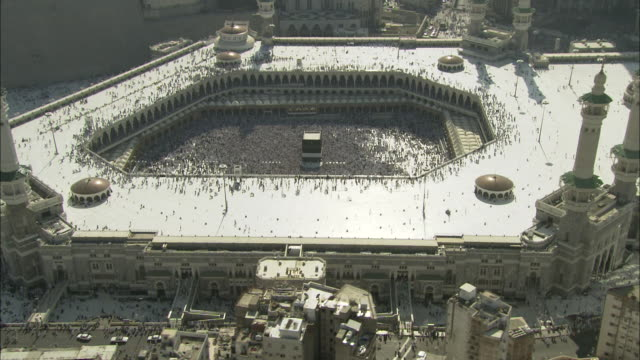 skyscrapers encircle a mosque and the sacred site of kaaba in mecca. - mecca stock videos and b-roll footage