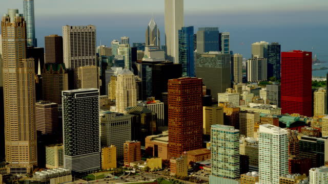 medium aerial skyscrapers in downtown chicago - two prudential plaza stock videos & royalty-free footage