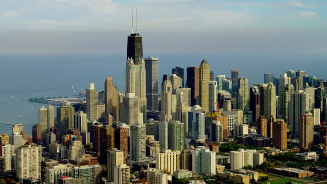 WIDE AERIAL skyscrapers in downtown Chicago with Lake Michigan in background