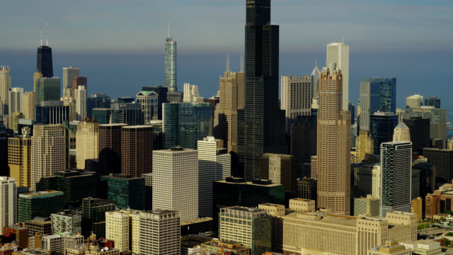 medium aerial skyscrapers in downtown chicago with lake michigan in background - two prudential plaza stock videos & royalty-free footage