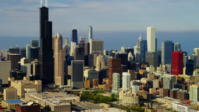 wide aerial skyscrapers in downtown chicago with lake michigan in background - two prudential plaza stock videos & royalty-free footage