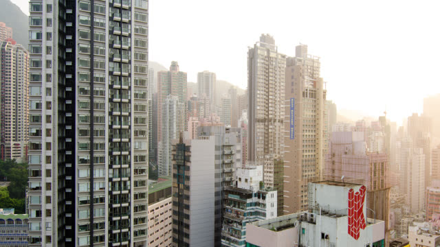 T/L PAN Skyscrapers in downtown Hong Kong  day to night transistion