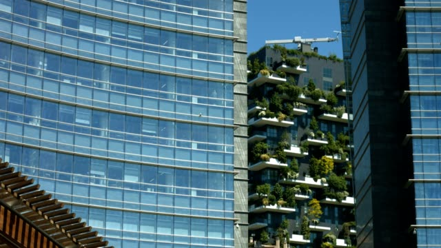 skyscrapers in gae aulenti square in milan - environmental conservation stock videos & royalty-free footage