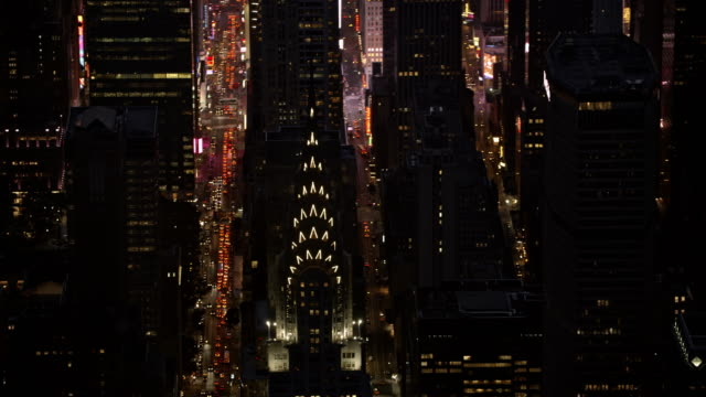 aerial skyscrapers in manhattan, new york at night - chrysler building stock videos & royalty-free footage