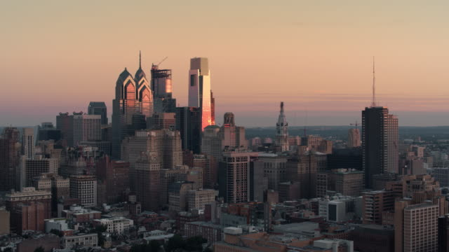 AERIAL Skyscrapers in the city of Philadelphia, PA at sunrise