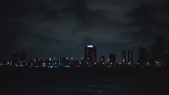 skyscrapers in the miami skyline overlook biscayne bay. - biscayne bay stock-videos und b-roll-filmmaterial