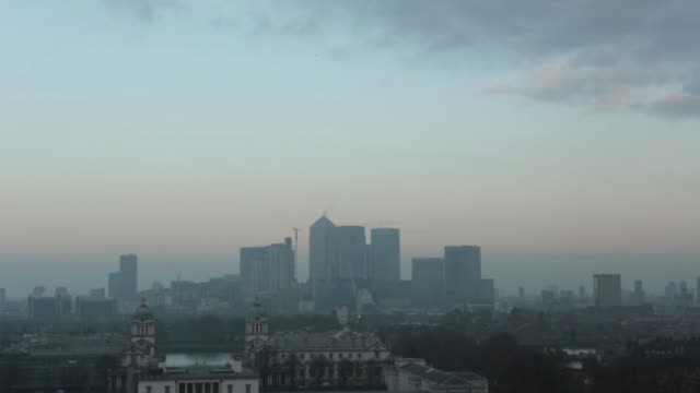 skyscrapers including one canada square center stand on the skyline at dawn in the canary wharf business financial and shopping district of london uk... - royal navy college greenwich stock videos & royalty-free footage
