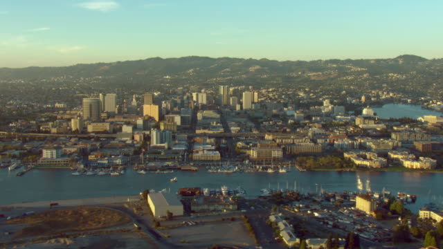 skyscrapers line oakland's inner harbor. - oakland california stock videos & royalty-free footage