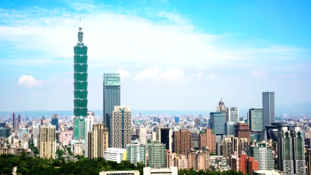 skyscrapers of a modern city with blue sky in taipei, taiwan - taipei 101 stock videos and b-roll footage