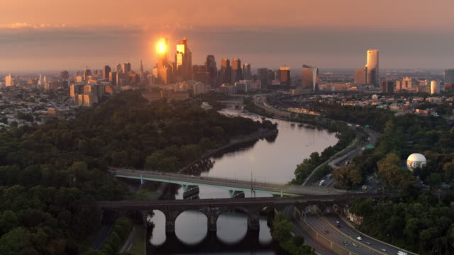 aerial skyscrapers of center city in philadelphia reflecting the rising sun - philadelphia pennsylvania video stock e b–roll