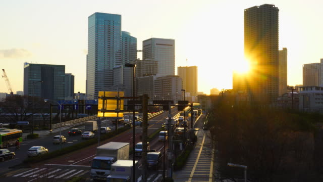 Skyscrapers of Harumi and Tsukishima area from Toyosu 2-chome Intersection at Harumi-Dori in sunset at Toyosu, Koto, Tokyo, Japan.