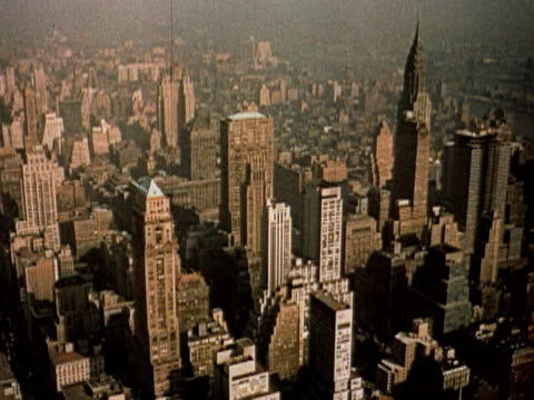 1960 ha pan skyscrapers of midtown manhattan shot from the empire state building / new york city - 1960 stock-videos und b-roll-filmmaterial