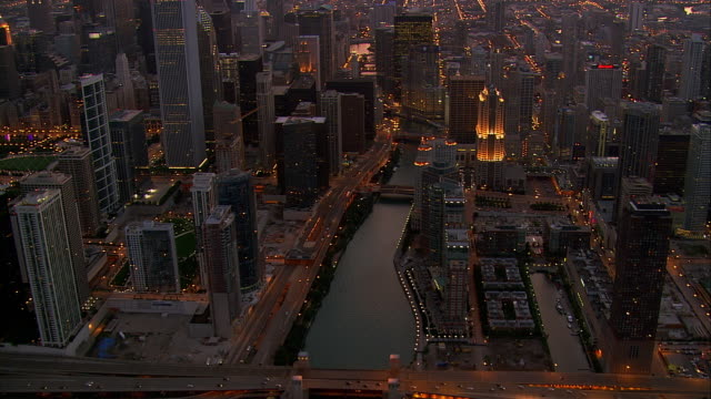 skyscrapers rise above chicago, illinois. - chicago river stock videos & royalty-free footage