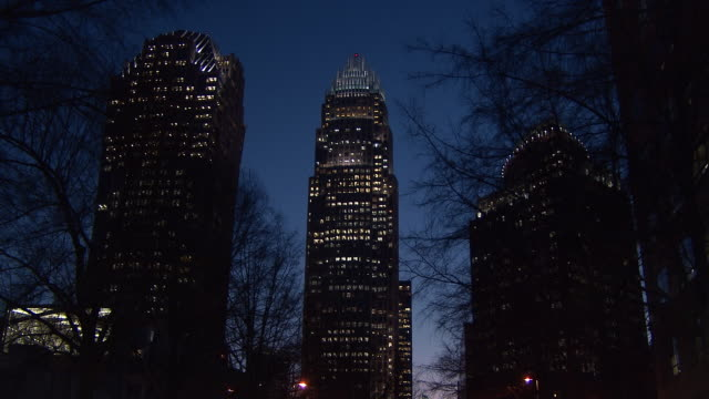 stockvideo's en b-roll-footage met skyscrapers rise above downtown charlotte, north carolina. - low angle view