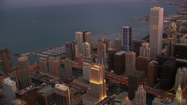 skyscrapers rise above lake michigan in chicago, illinois. - two prudential plaza stock videos & royalty-free footage