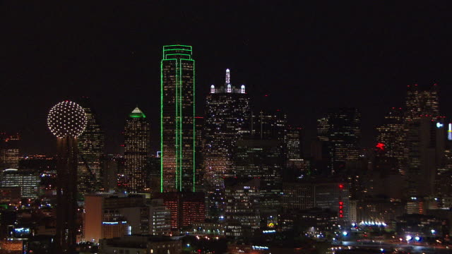 Skyscrapers shine brightly in Dallas, Texas at night.