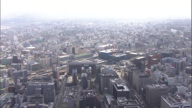 vídeos de stock, filmes e b-roll de skyscrapers surround hakata station in fukuoka city, japan. - prefeitura de fukuoka