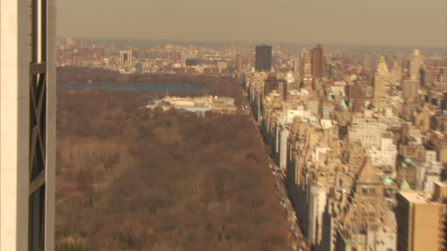skyscrapers tower above central park in new york city. - population explosion stock videos & royalty-free footage