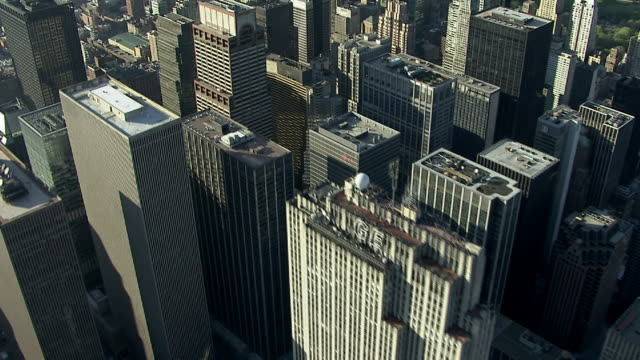 skyscrapers tower above the streets of manhattan. - manhattan video stock e b–roll