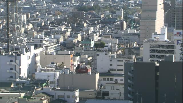 skyscrapers tower over surrounding buildings in kofu, japan. - 山梨県点の映像素材/bロール