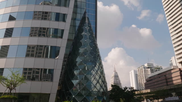 skyscrapers with clouds reflected in glass walls. - mckyartstudio stock videos and b-roll footage