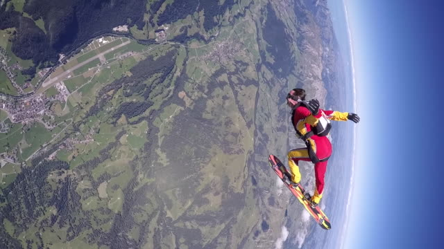 skysurfing above alps - skydiving stock videos & royalty-free footage