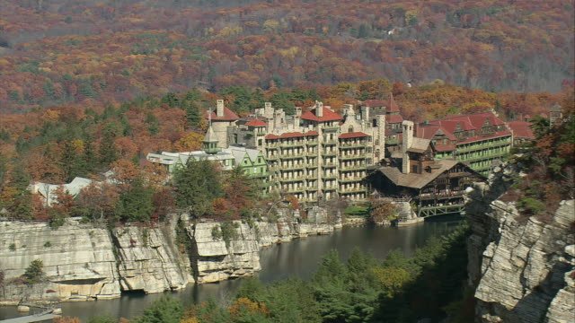 aerial skytop tower rising above mohonk mountain house / new paltz, new york, united states - mohonk stock videos and b-roll footage